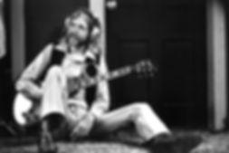 duane on floor in studio w strap getty i