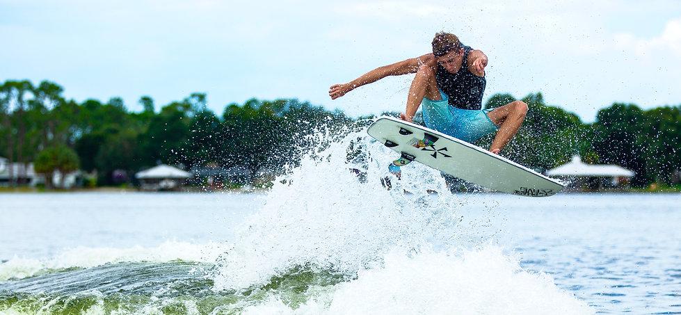 Wakesurf Orlando team rider Parker Payne wakesurfing on the Phase 5 Phantom Wakesurf Board
