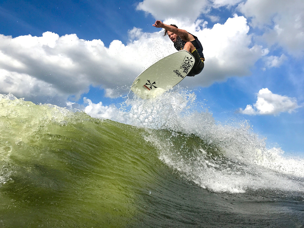 Wakesurf Orlando with Nick Parros boosting a Frontside Air on the Phase 5 Phantom Wakesurf Board