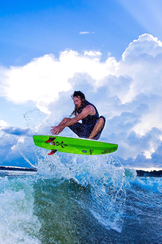 Wakesurf Orlando with Captain Tarzan kicking out a Frontside Air on the Phase 5 Phantom