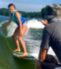 Wakesurf Orlando head coach Captain Tarzan teaching Elle wakesurfing lessons on the Phase 5 Matrix wakesurf board