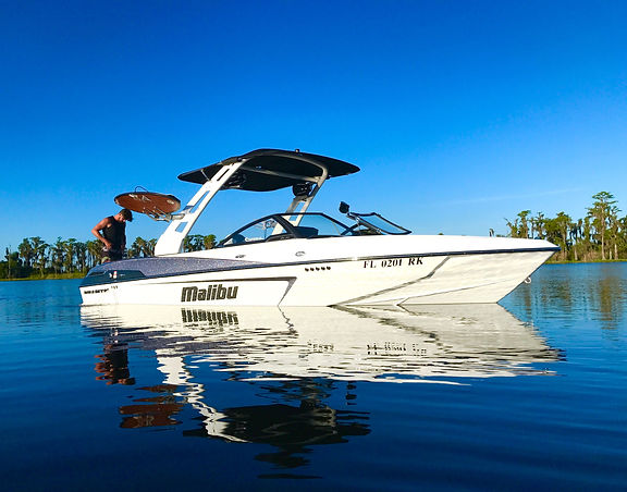 Wakesurf Orlando with our Tommy's Malibu 23 LSV Wakesetter Wakeboat