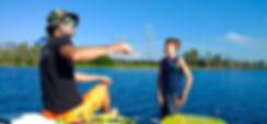 Wakesurf Orlando head coach Captain Tarzan teaching Hunter wakesurfing lessons on the Phase 5 Race