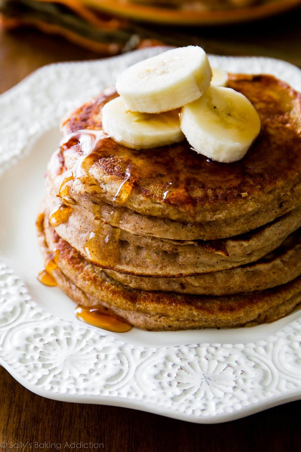 pancakes, bananas, healthy, syrup, white plate, stack of pancakes