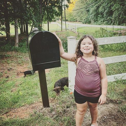 Mariah at the Mailbox.JPG