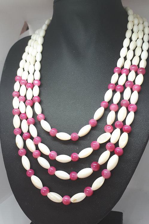 Silver tone multi strand shell and pink quartzite necklace
