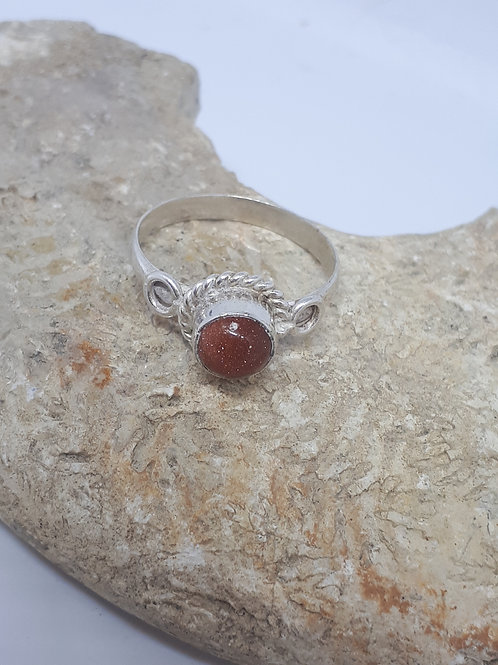 Silver plated goldstone ring - size P