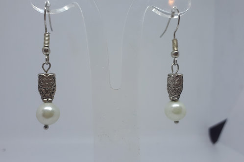 Silver plated pastel blue shell pearl owl earrings