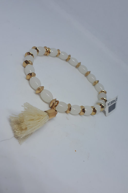 Gold tone and white bead stretchy tassel bracelet