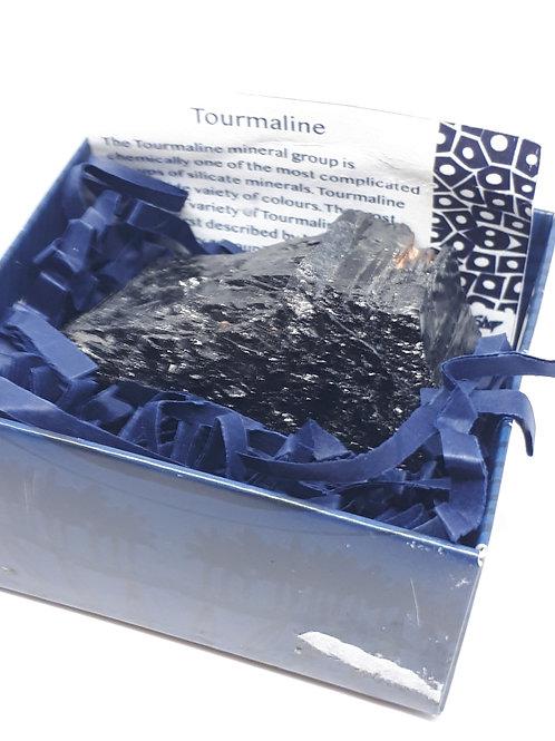Black tourmaline rough in a box