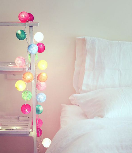 Cotton ball LED fairy lights hanging in a bedroom