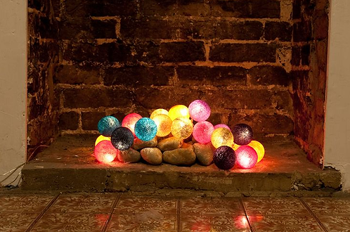 Cotton ball LED fairy lights decorating an empty hearth