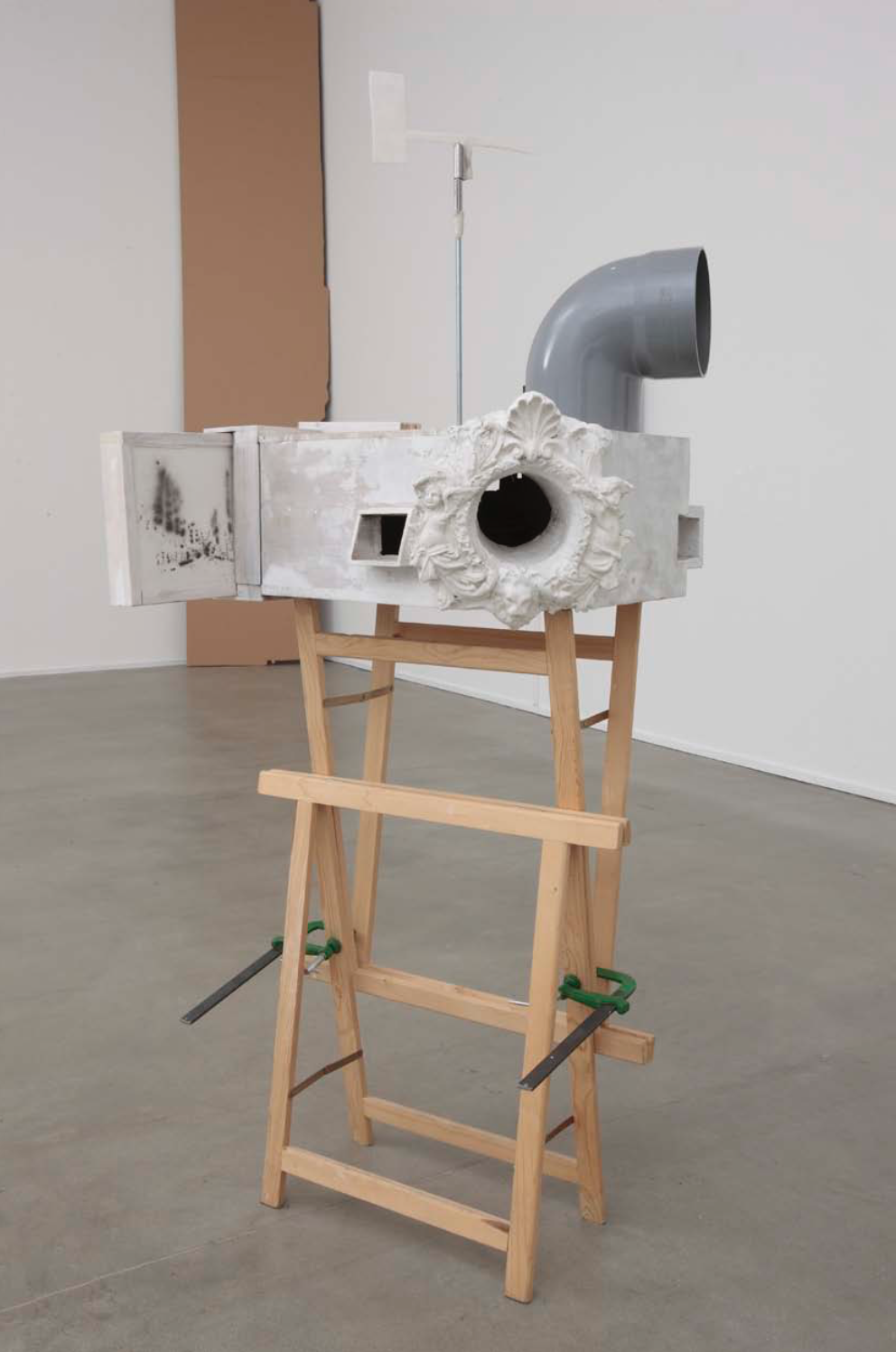 wrapped in thought, 2009 - sculpture, wood, plastic, plaster, iron, steel, paper, dust, ber 50 cmx 4