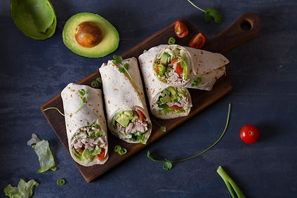 Chicken wraps with avocado, tomatoes and