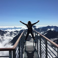 person-standing-on-hand-rails-with-arms-