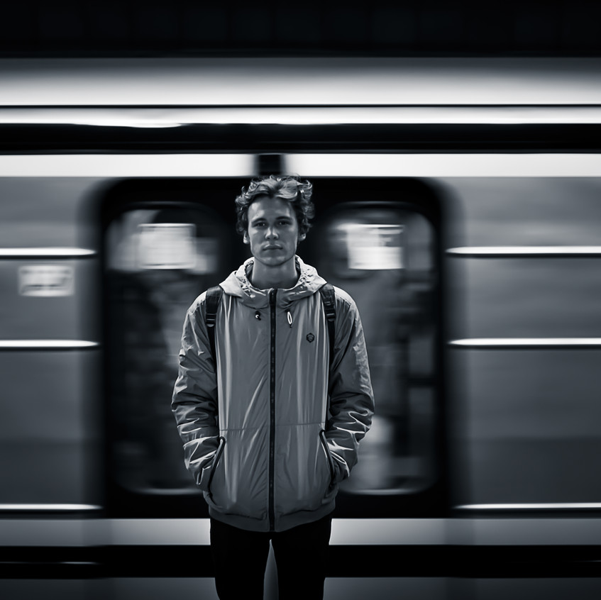 Man in front of Subway