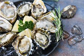 bigstock-Fresh-Oysters-Seafood-On-A-Bla-