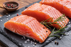 bigstock-Fresh-salmon-fillets-on-black--