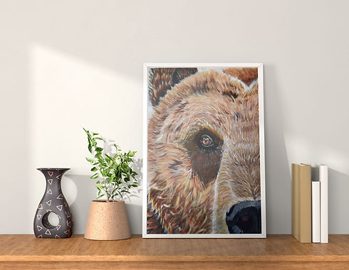 Framed print of a bear on desk