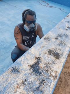 Ali cleaning Pool.jpg