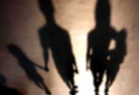 Blurry shadows silhouetes of family with