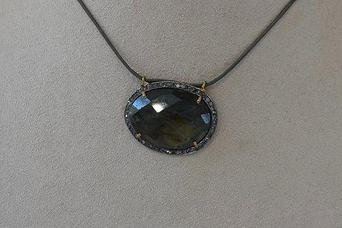Labradorite surrounded in pave diamonds.