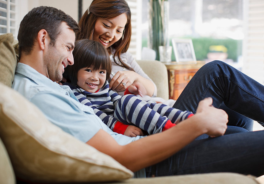 Family-relaxing-together-on-sofa-1430709