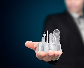 Businessman with city in the hands..jpg