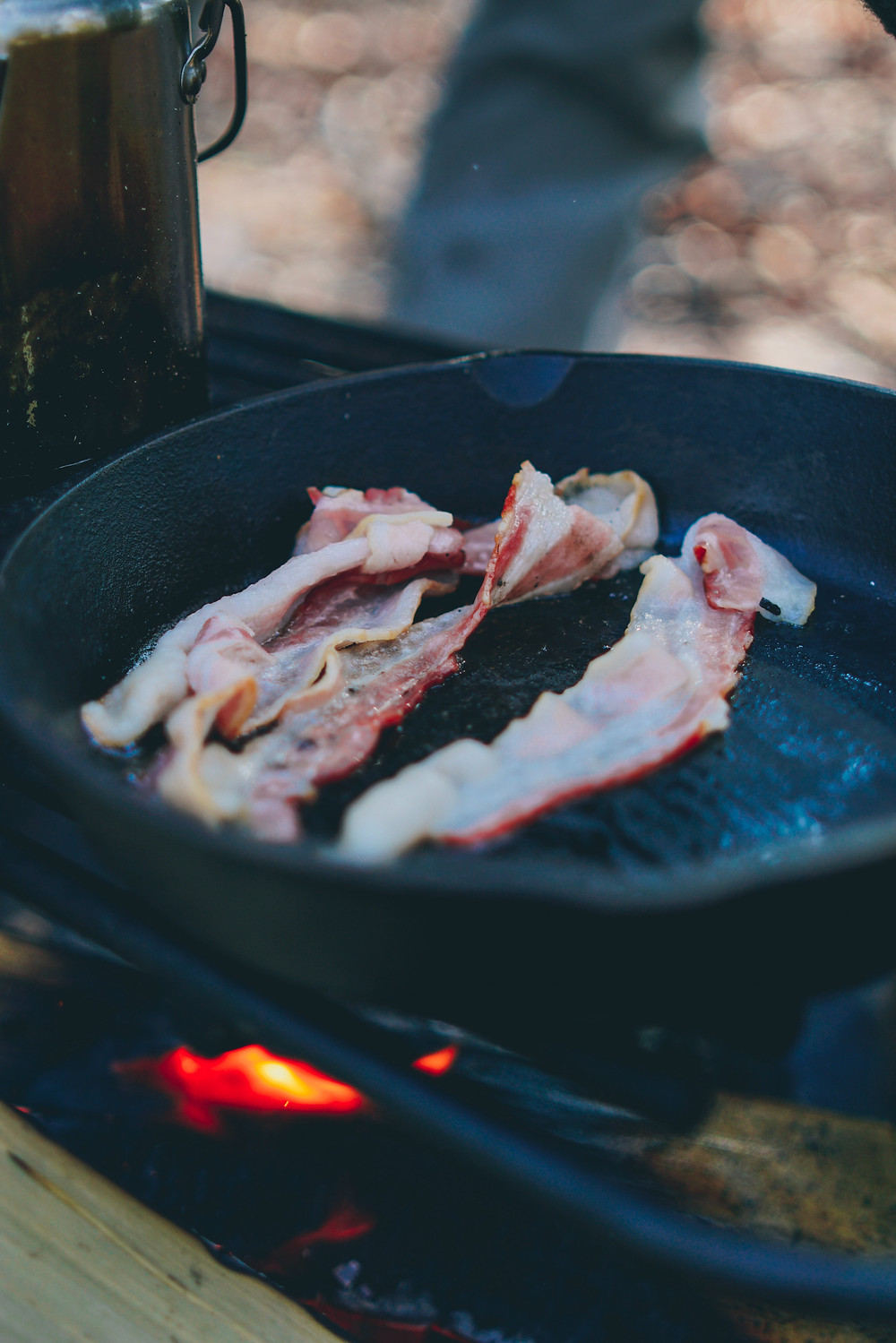 Bacon being cooked outdoors