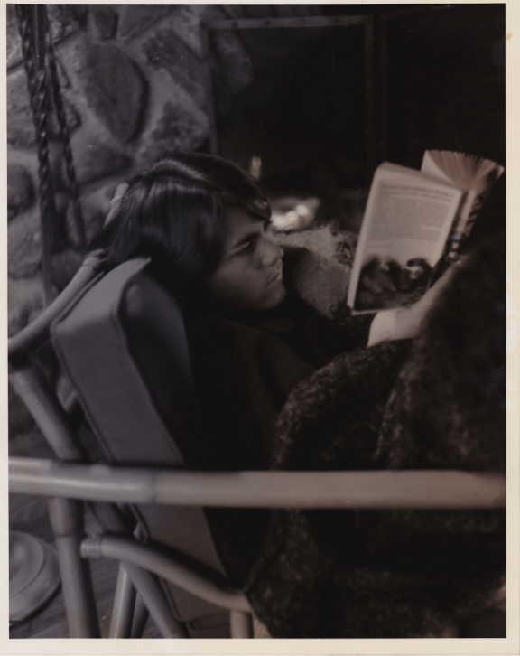 teenage girl reading a book