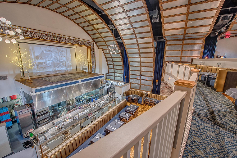 Interior of Webb Custom Kitchen, a former grand movie theater turned restaurant.