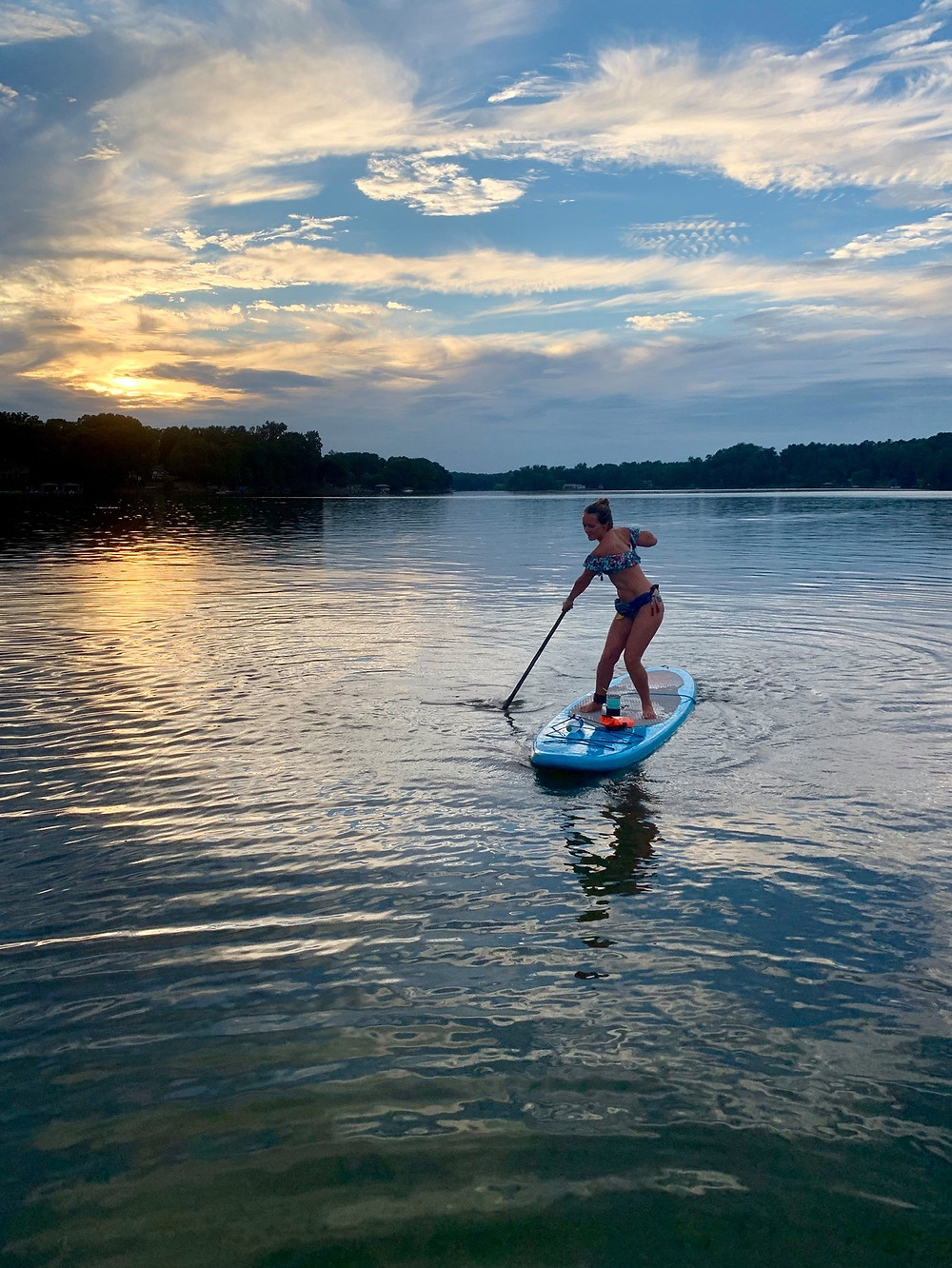 A paddleboarder glides along the Catawba River