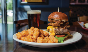 Bad Daddy's thick burger topped with buttermilk fried bacon