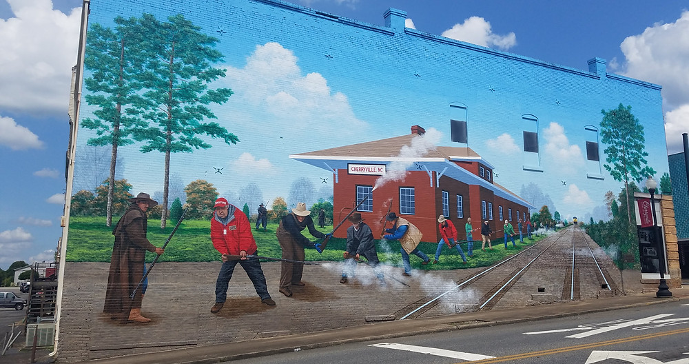 A mural in downtown Cherryville depicts the yearly tradition of the New Year's Shooters.
