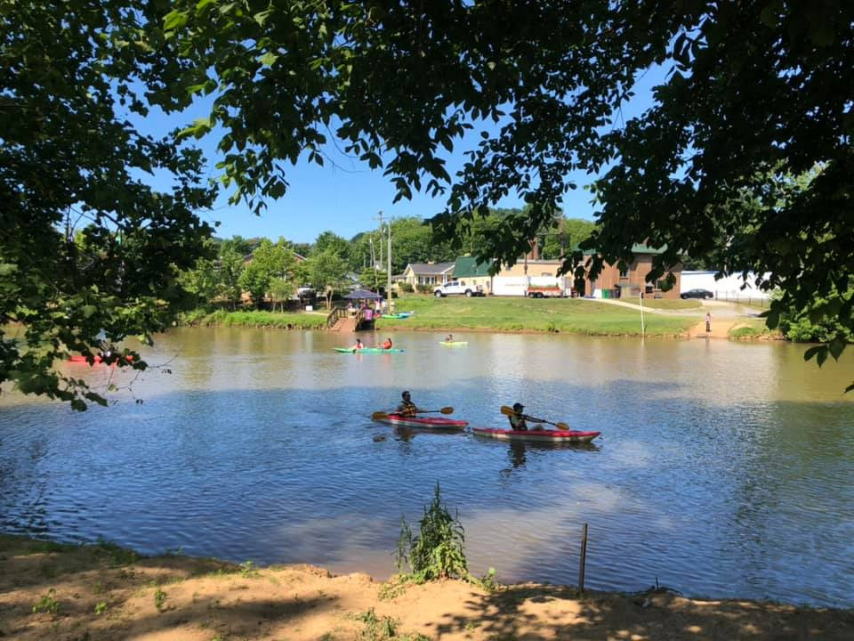 Two kayaks float down the Catawba River