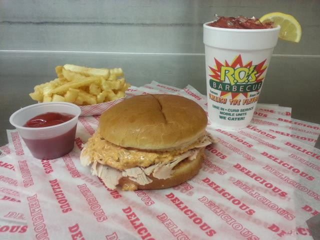 R.O.'s signature pulled pork sandwich with a side of curly fries