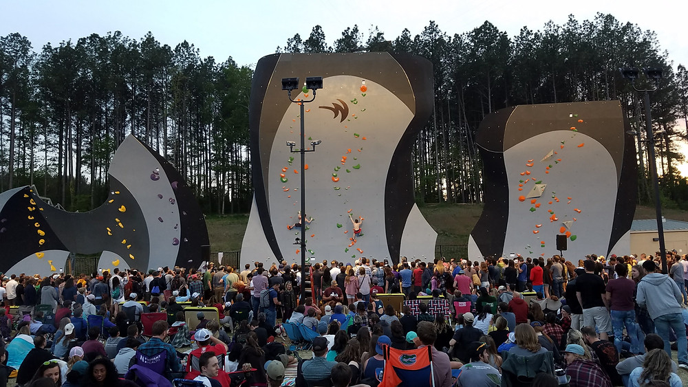 Crowds watch climbers compete on the deep water solo wall at the USNWC
