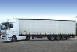 tarpaulin-covered trailers