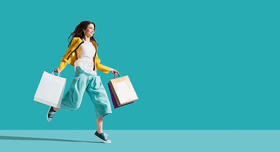 Cheerful happy woman enjoying shopping: