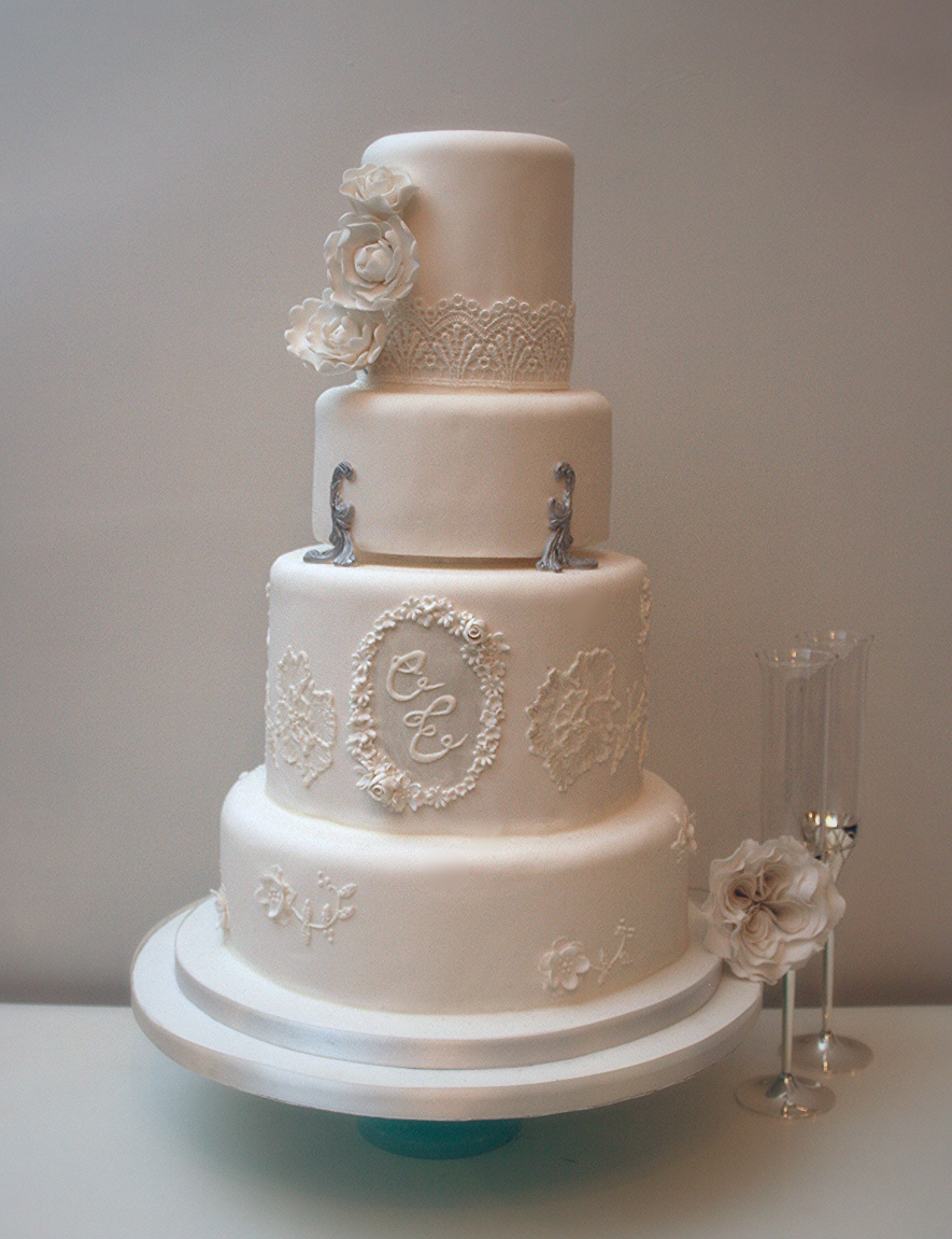 Elegant White Monogram Wedding Cake