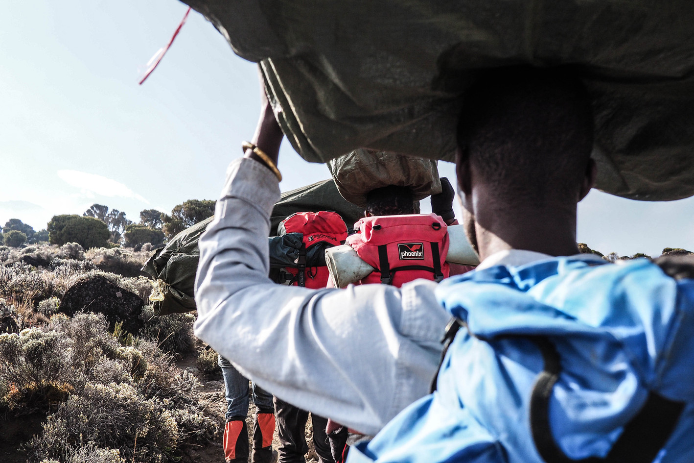 Porters carry loads to a camp high on the slopes of Mount Kilimanjaro, Africa's tallest peak.