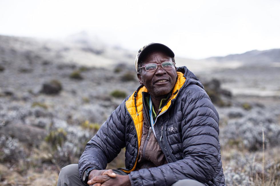 James Kagambi, a veteran Kenyan mountaineer and educator, takes a break in the moors near Horombo, on Kilimanjaro.