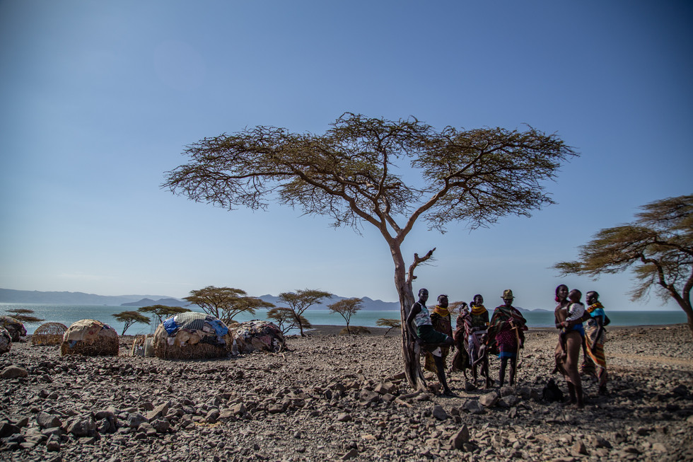 A village of the Turkana tribe hide from the unrelenting noonday heat of desertous northern Kenya.