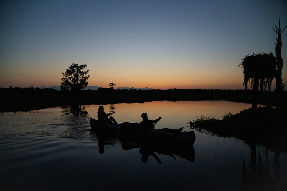 Outward Bound students float the Ocklawaha river of central Florida at dusk.