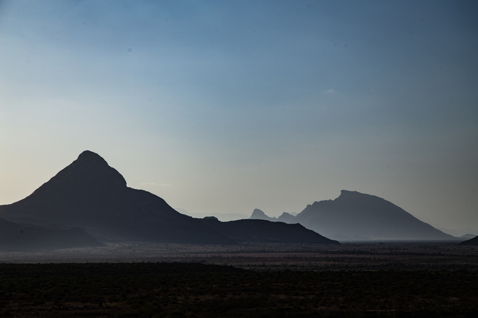 Dusk encroaches the far perimeter of the rugged Ndoto Mountains in central Kenya.