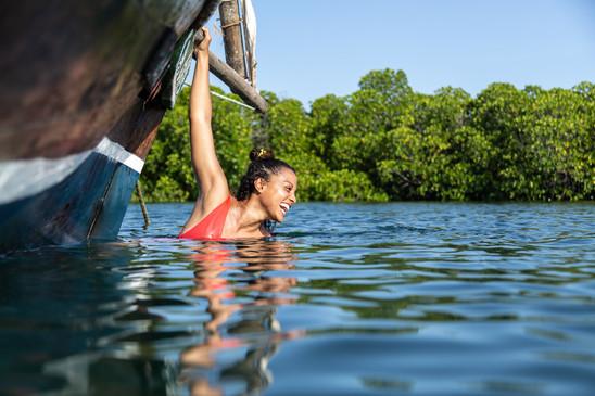 Relaxing in the mangrove swamps near Lamu Island on the Swahili Coast of Kenya.