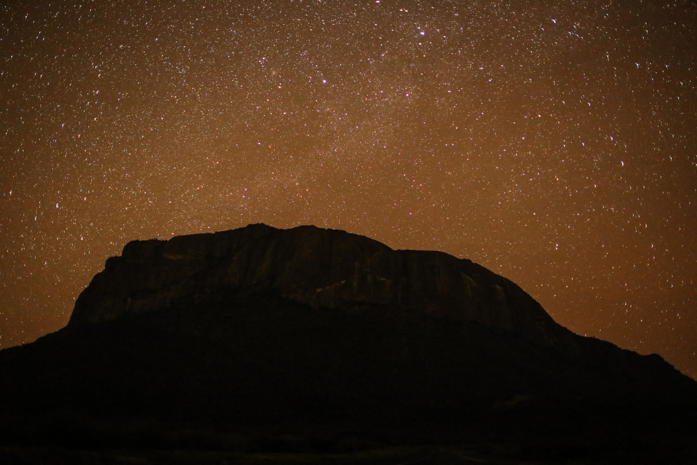 A sacred mountain under a sacred sky. Ololokwe at night.
