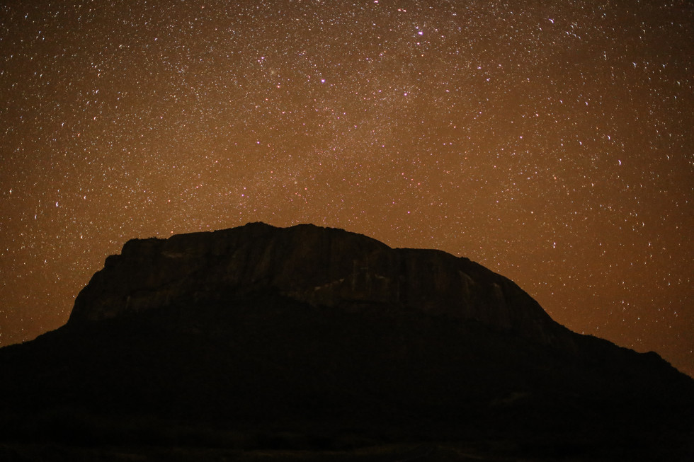 A sacred mountain under a sacred sky. Ololokwe at night. For Climbing Magazine.