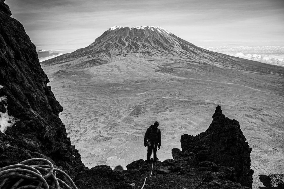 Steven Masaga stands in the Oehler Gully on Mawenzi, a subsidiary peak of Mount Kilimanjaro. Published in Alpinist Magazine.
