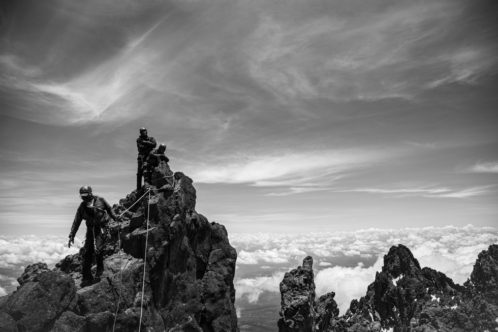 Climbers summit Mawenzi Peak, the fourth highest point in Africa, little-known and rarely climbed in the shadow of Kilimanjaro.
